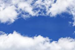 Blue sky background with clouds, aerial view - stock photo
