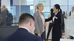 4K Modern city bank, man assisting customer & getting signature on document Stock Footage