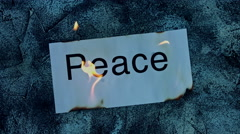 4k shoot of a creative composition with peace word on fire - stock footage