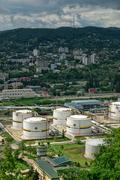 Tuapse, Russia - May 10, 2008:Oil storage area with white tanks on Black sea - stock photo