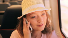 Young woman talking on the phone while traveling on the train. Stock Footage