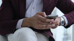 Happy businessman with mobile telephone or smartphone, visiting web site and Stock Footage