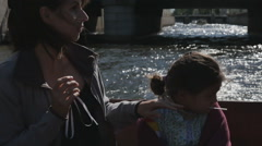 Two little girls with their parents in a tourist boat along the rivers Stock Footage