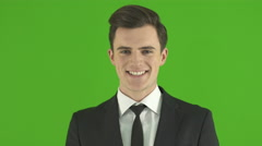 The man smile on the green background. Real time capture Stock Footage