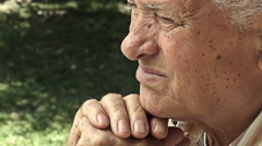 Calm and serene old man's portrait: pensive peaceful elderly man Stock Footage