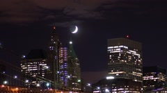 Time-lapse of the crescent moon in Manhattan with pan over the Brooklyn Bridge Stock Footage