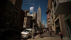 Hyperlapse in Midtown Manhattan by the Empire State Building Stock Footage