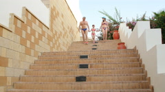 Family walking on stairs Stock Footage