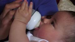 Baby bottle feeding Stock Footage