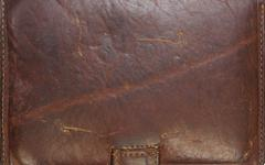 Closeup detail on old brown leather texture background. - stock photo