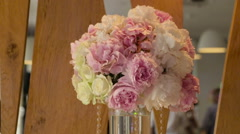 Beautiful wedding decorations to wedding. Beautiful flowers are on the table - stock footage