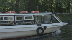 The waterbus sails past the Park Stock Footage