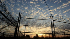 4k - Barbwire fence and amazing time lapse skies Stock Footage