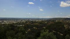Griffith Park trails and Los Angeles with Pacific Ocean in the horizon Stock Footage