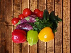 Crop of vegetables. Potatoes, tomatoes, cucumber, peppers, eggplant and other Stock Photos