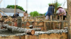 Workers pouring cement foundation for house building Stock Footage