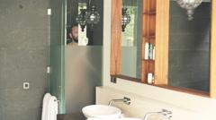 Man taking bath under shower in the bathroom Stock Footage