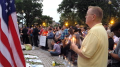 Medium shot of Orlando mass shooting vigil  - stock footage