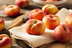 Raw Organic Donut Saturn Peaches - stock photo