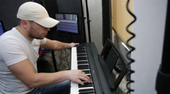The guy playing the electric piano. Stock Footage