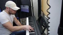 The guy likes to play the piano Stock Footage