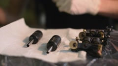 Tattoo machine. tattoo artist tattoo machine prepares to work. sterile and tidy. Stock Footage