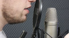 Recording a vocalist in a recording Studio Stock Footage