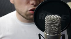 Man singing into the microphone at a recording Studio Stock Footage