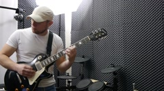 Recording  guitarist plays Stock Footage