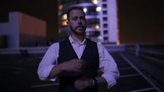 Man crossed his arms at night in city Stock Footage