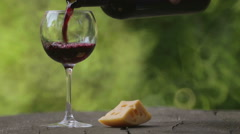 Red wine is poured into a glass. Stock Footage