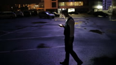 Businessman consult by phone in difficult decisions in night city Stock Footage