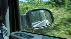 Rearview Side Car Mirror While Driving - stock footage