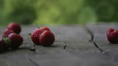 Fresh strawberries falling on the table. Stock Footage