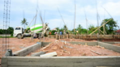 Workers pouring cement foundation for house building (defocused) Stock Footage