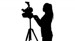 Operator removes the part of the video clip in the studio. White. Silhouette Stock Footage
