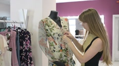 Woman Dressing Mannequin at store - stock footage