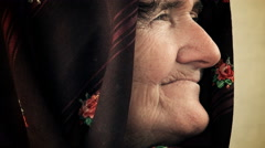 portrait of a serene old woman with a shawl on her head - stock footage