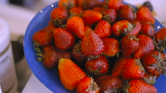 Strawberries in glass dish glider closeup Stock Footage