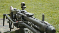 Black heavy machine gun in the field Stock Footage