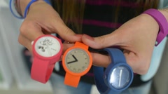 Girl get shopping in a store chooses Wrist Watch O Bage Stock Footage