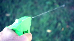 Slow motion spraying poison pestacisde spraying in yard 2 Stock Footage