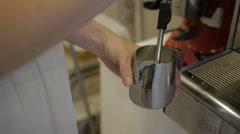 Hand girl baristas dub coffee from holder coffee machines Stock Footage