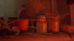 Tools of the artist lying in his dark workshop panoramic shot Stock Footage