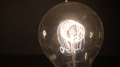 Old timey lightbulb light bulb edison Stock Footage