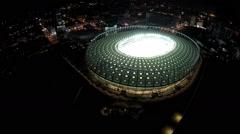 Modern stadium hosting football championship, aerial view, camera moving away - stock footage
