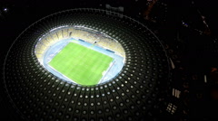 Bird's eye view on big soccer stadium with players, exciting football game - stock footage