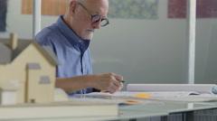 Architect working on blueprints Stock Footage