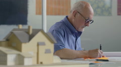 Architect working on drawings Stock Footage