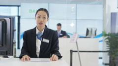 4K Bank with friendly adviser talking to customer, as seen from customer's pov Arkistovideo